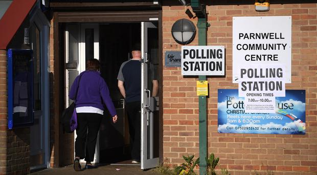 Members of the public enter the polling station at Parnwell Community Centre in Peterborough (PA)