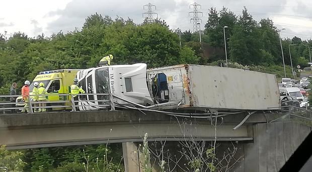 An eyewitness said the lorry was hanging precariously (Roxy Louise Sier/PA)