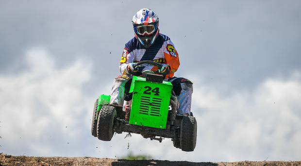 A competitor during the Red Bull Cut It lawnmower racing event in Lower Weare, Axbridge (Ben Birchall/PA)