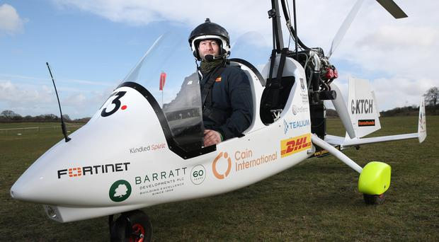 James Ketchell in his open cockpit gyrocopter (Andrew Matthews/PA)