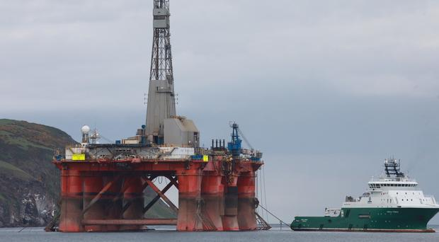 An oil rig which has been scaled by climate change protesters (Greenpeace/PA)