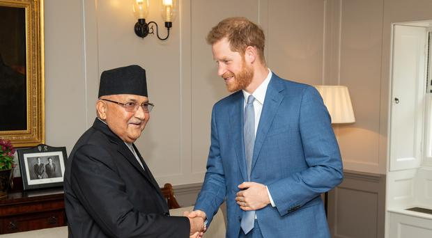 The Duke of Sussex meets the Prime Minister of Nepal KP Sharma Oli (Dominic Lipinksi/PA)