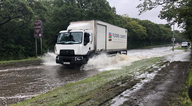 Floods make driving difficult on Parkgate Road in Chester (PA)