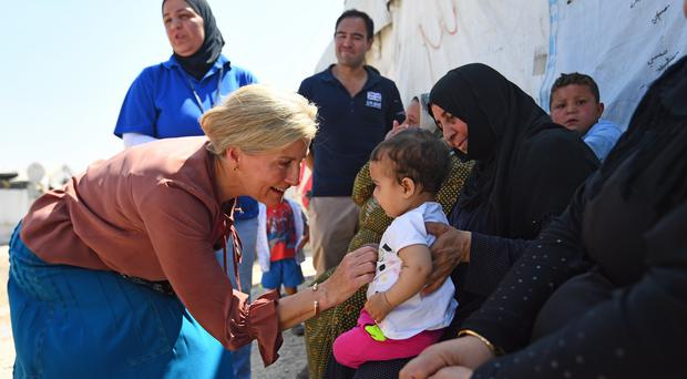 The Countess of Wessex meets a Syrian woman and child, amongst refugees displaced to Lebanon, on a visit to an informal tented settlement in the Bekaa Valley (Victoria Jones/PA)