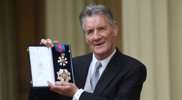Sir Michael Palin after he was made a knight by the Duke of Cambridge (David Mirzoeff/PA)