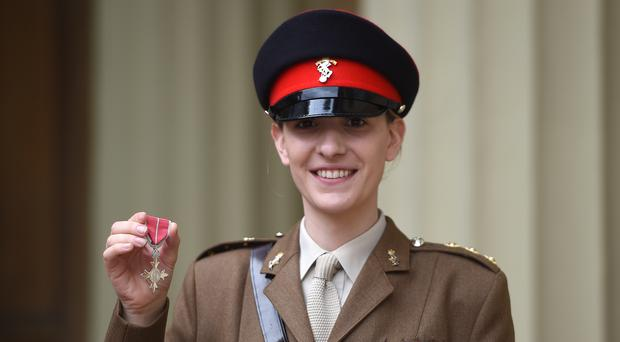 Captain Hannah Graf with her MBE (David Mirzoeff/PA)