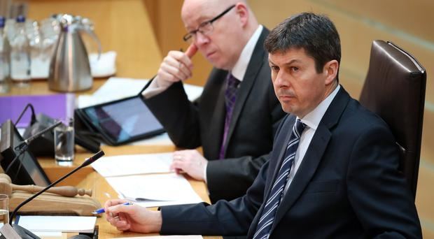 Holyrood chief executive Sir Paul Grice (left) is to leave the Scottish Parliament (Jane Barlow/PA)