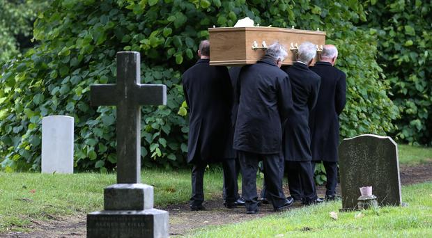Pall-bearers carry the coffin of Jeremy Kyle Show guest Steve Dymond during his funeral at Kingston Cemetery in Portsmouth (Andrew Matthews/PA)