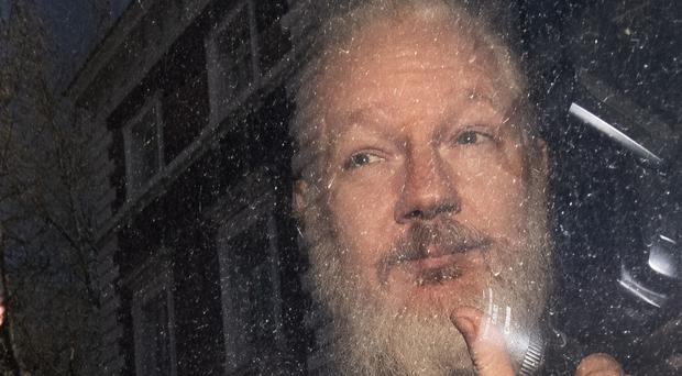 Julian Assange is serving a 50-week prison sentence for a bail violation (Victoria Jones/PA)