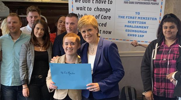 First Minister Nicola Sturgeon meets care-experienced young people in Glasgow(Lewis McKenzie/PA)
