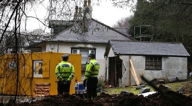 Police search a cottage and its grounds where Margaret Fleming lived in Inverkip (Andrew Milligan/PA)