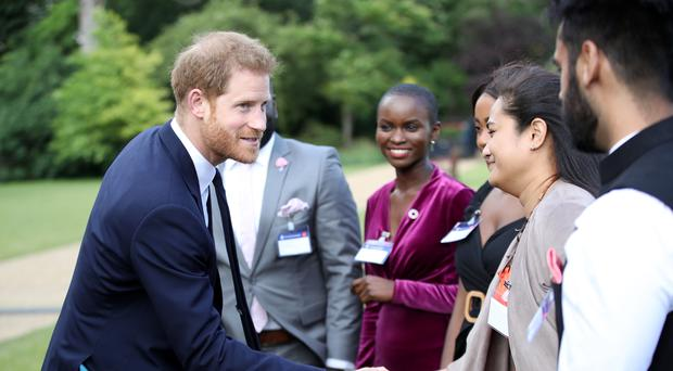 The Duke of Sussex meets some of the guests (Chris Jackson/PA)