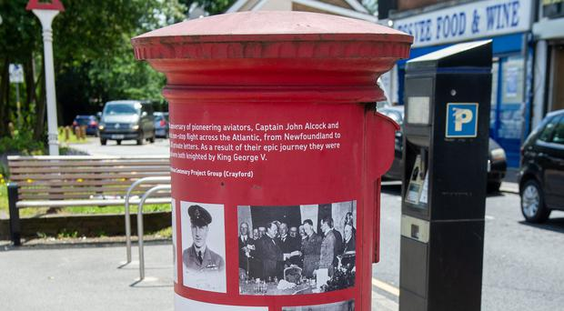 A postbox on Harlington High Street that has been decorated to commemorate 100 years of pioneering aviators Captain John Alcock and Lieutenant Arthur Whitten Brown (Royal Mail/PA)