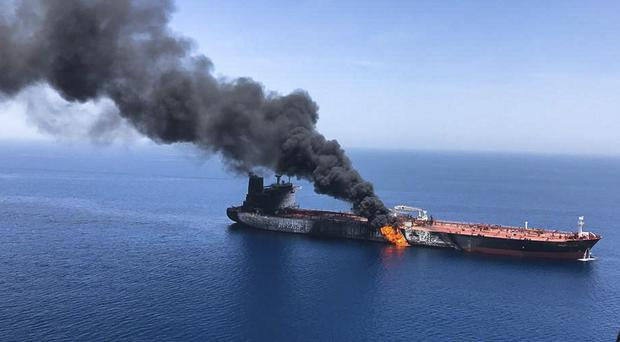 An oil tanker on fire in the sea of Oman (ISNA/AP/PA)