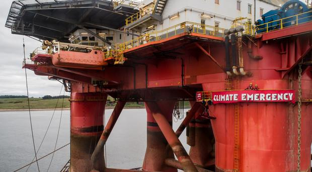 Greenpeace activists unfurled a banner on the rig (Greenpeace/PA)