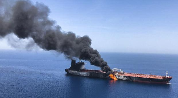 An oil tanker on fire in the Gulf of Oman following an alleged Iranian attack (ISNA/AP/PA)