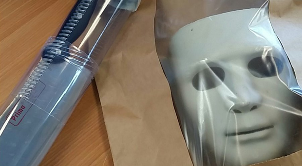 The knife and mask seized by police after a man terrified members of the public in Newquay (Newquay Police/PA)