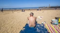 British holidaymakers are also splashing out more money on their summer break, the survey found (Danny Lawson/PA)