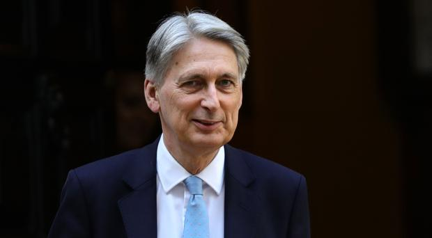 Philip Hammond called on the leadership rivals to commit to keeping the national debt falling every year (Aaron Chown/PA)