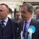 Nigel Farage (right) after he was doused in milkshake (Tom Wilkinson/PA)