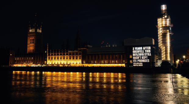 The projection on the Houses of Parliament (Grenfell United/PA)