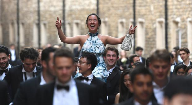 Students from Cambridge University make their way home along Trinity Lane after celebrating the end of the academic year at the May Ball (Joe Giddens/PA)