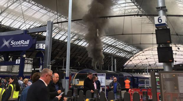 Smoke was seen billowing from a train at Queen Street station (@Holly_Rumble/Twitter/PA)