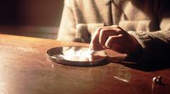 A man using the Class A drug cocaine (Chris Young/PA)