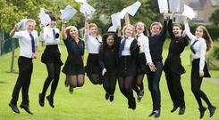 Pupils celebrating exam results (Andrew Milligan/PA)