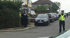 Police at the scene in Luton (Samar Maguire/PA)