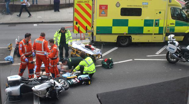 The scene of the accident after a woman was in a collision with a police motorbike escorting the Duke and Duchess of Cambridge (PA)