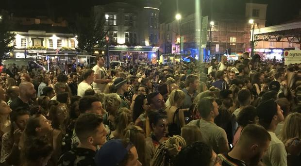Crowds of people outside Brighton train station following Brighton Pride in 2018 (@JevdetOrgen)