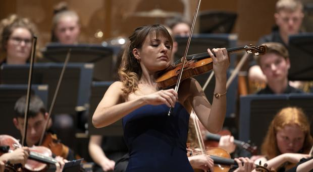 Violinist Nicola Benedetti performs with around1,200 school pupils, forming one of the largest orchestras ever assembled in Scotland (Jane Barlow/PA)
