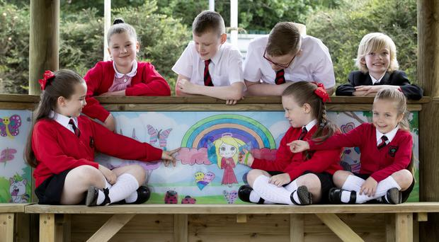 Pupils (top, from left) Chloe Adams, 11, Aaron Reid, 10, Kerr Reid, 12, and Felix Sneddon, 8, with (front) sisters Kacie, 9, Isla, 7, and Jorgia Cowie, 5, from Chapelside Primary School (Jane Barlow/PA)