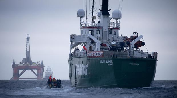 Greenpeace ship Arctic Sunrise following the BP Transocean PBLJ oil rig (Jiri Rezac/Greenpeace/PA)