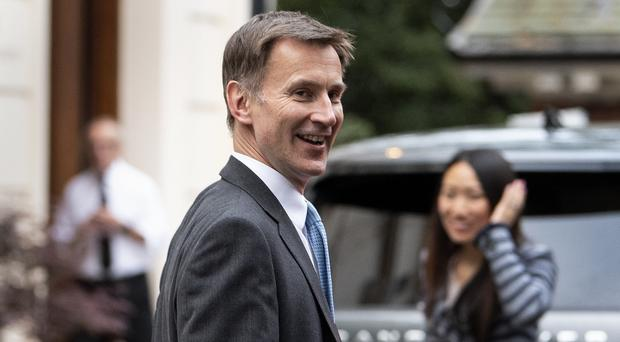 Foreign Secretary Jeremy Hunt and his wife Lucia arrive back at their London home following the fifth vote (Victoria Jones/PA)