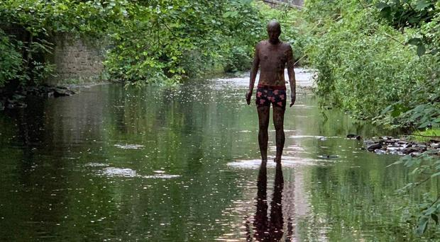 The Antony Gormley statue has been dressed in pants (Graham Paton/PA)