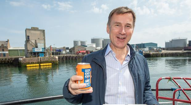 Conservative party leadership candidate Jeremy Hunt has some fish and chips and a can of Irn Bru (Michal Wachucik/PA)
