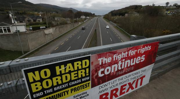 Border Communities Against Brexit hold protests on Old Belfast Road in Carrickcarnon on the northern side of the Irish border (Niall Carson/PA)