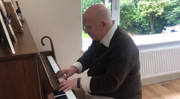 Paul Harvey, who has dementia, plays a piece he composed in the 1980s on the piano (Nick Harvey/PA)