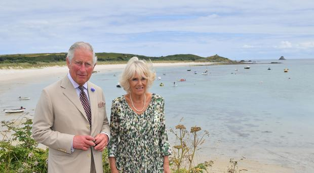 The Prince of Wales and Duchess of Cornwall on the Isles of Scilly (Ben Birchall/PA)