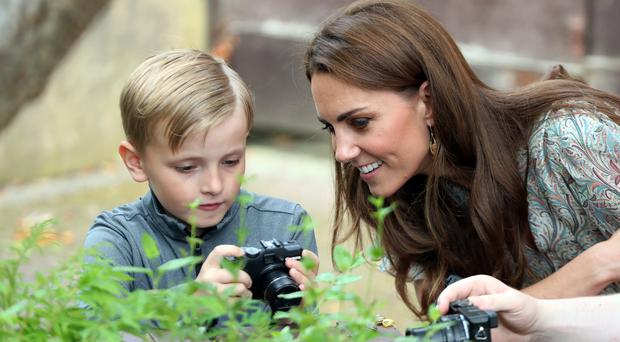 The Duchess of Cambridge meets Josh Evans during a visit to a Royal Photographic Society workshop in Kingston upon Thames (Chris Jackson/PA)
