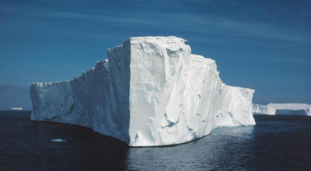 An iceberg in Antarctica as new research discovers when the current that swirls round the continent first began (C.Gilbert/PA)