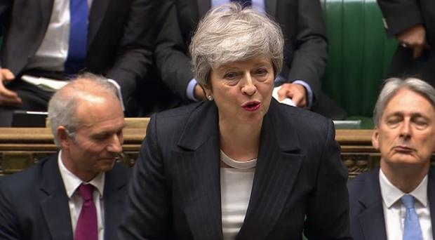 Theresa May at Prime Minister's Questions in the House of Commons (PA)