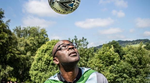 Lillian Thuram plays with a football on the university campus (University of Stirling/PA)