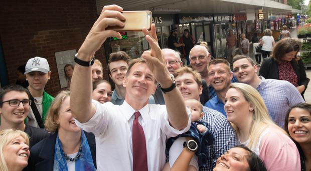 Conservative party leadership candidate Jeremy Hunt takes a selfie with supporters during a visit to Chelsmford town centre in Essex (Stefan Rousseau/PA)