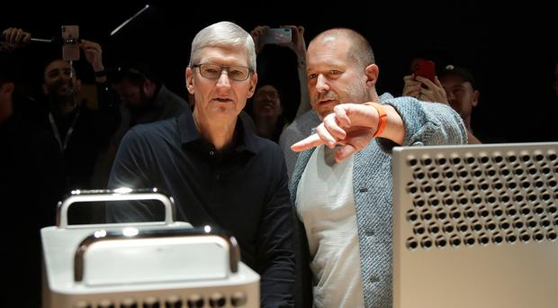 Tim Cook and Jonathan Ive look at the Mac Pro at the Apple Worldwide Developers' Conference (Jeff Chiu/AP)