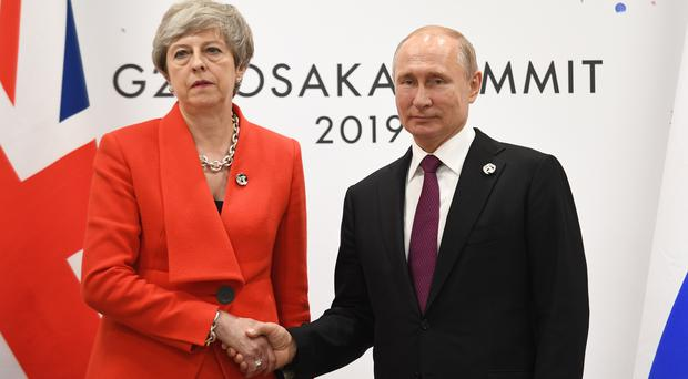 Prime Minister Theresa May meets Russian President Vladimir Putin during the G20 summit in Osaka, Japan (Stefan Rousseau/PA)