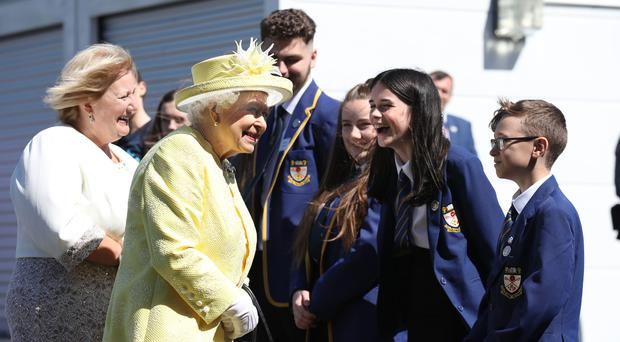 The Queen chats with pupils during a visit to Greenfaulds High School , Cumbernauld (Andrew Milligan/PA)