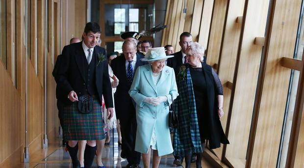 The Queen will address the Scottish Parliament to mark its 20th anniversary (PA)